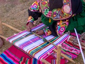 Viventura  Woman weaving in Capachica, Peru